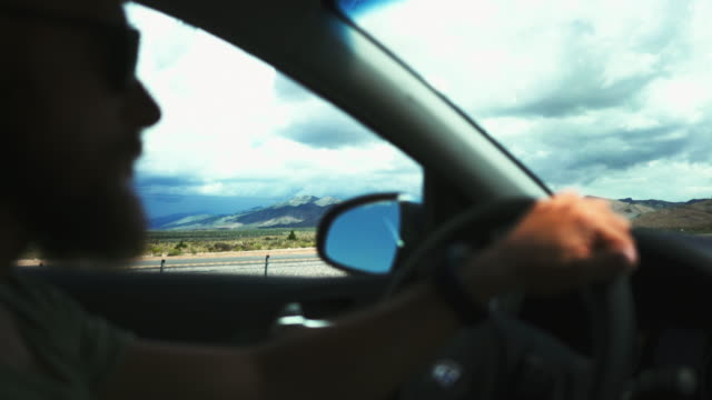 driving a car on desert highway pov - parco statale del red rock canyon video stock e b–roll