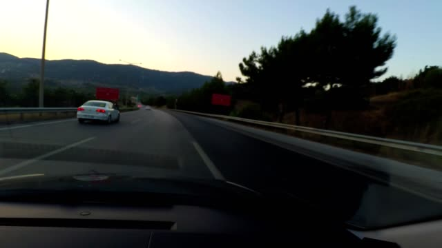 Driving a car on highway. pov view from car dashboard.