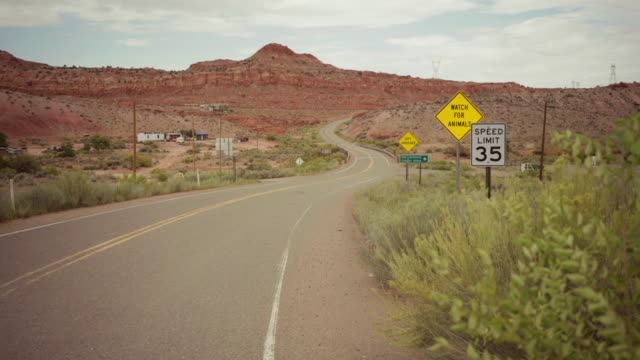 driving a car on winding desert highway - parco statale del red rock canyon video stock e b–roll
