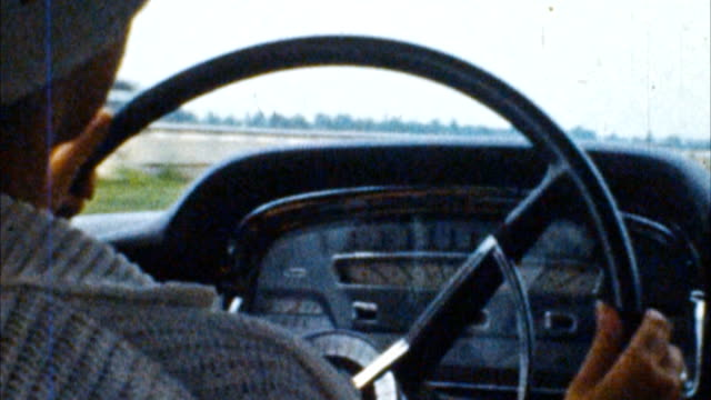 Driving a Car (Archival 1950s) Shot on Super 8mm film, 16fps. Telecine HD frame by frame digital 4:2:2 transfer. We keep all our original films stored in an archival film vault. the past stock videos & royalty-free footage