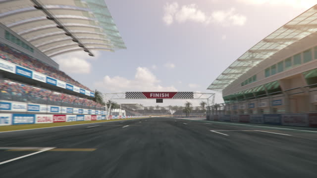 Driving along a single-seater auto racing race track across finish line