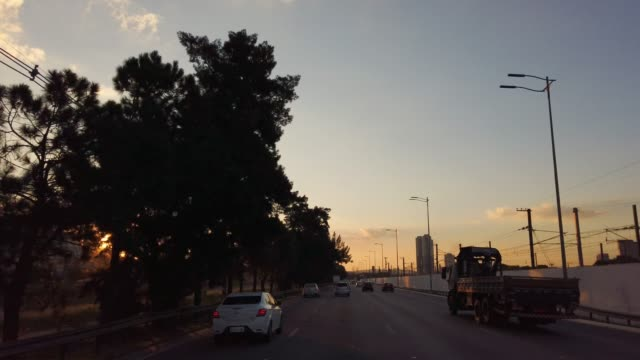 Driving at Marginal Pinheiros in Sao Paulo city. Sunset time. Video taken by car driving at Marginal Pinheiros in Sao Paulo city. Sunset time. marginal pinheiros stock videos & royalty-free footage