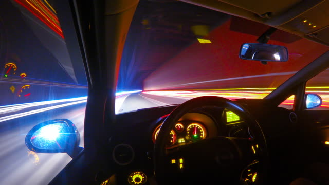 driving at night on a highway personal perspective time lapse - esposizione lunga video stock e b–roll