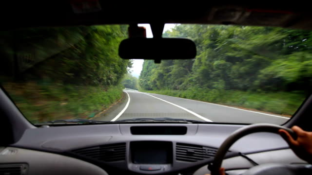 Driving at rainy mountain road. video