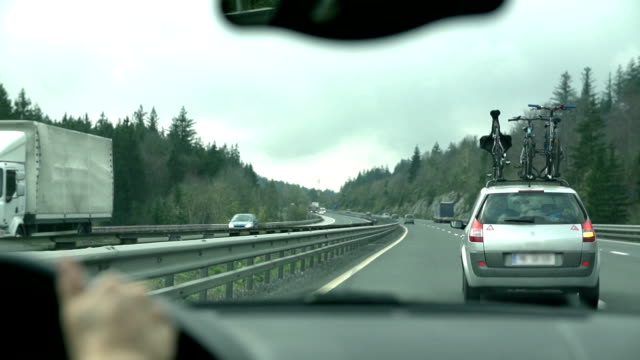 HD SLOW: Driving by a car with bikes on roof video
