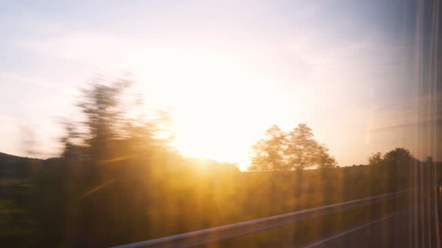 Driving by landscapes at sunrise