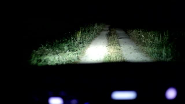 vídeos de stock e filmes b-roll de hd: condução carro à noite - driveway, no people