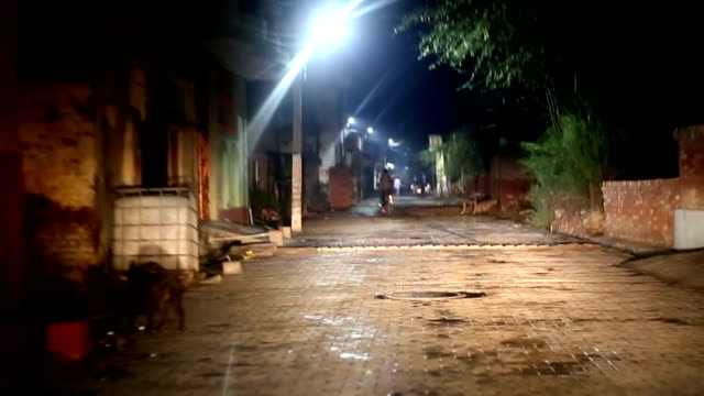 Driving car at night Driving car at night on country road in village view from inside the car. haryana stock videos & royalty-free footage