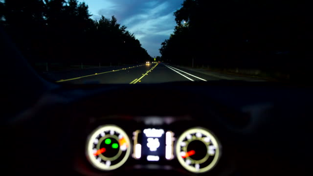 Driving car dashboard steering vehicle point of view dusk night