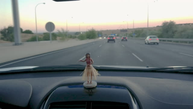 driving car interior with a hawaian dancer doll driving car interior with a hawaian dancer doll doll stock videos & royalty-free footage