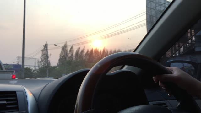 Driving car scene, human hand controlling steering wheel video