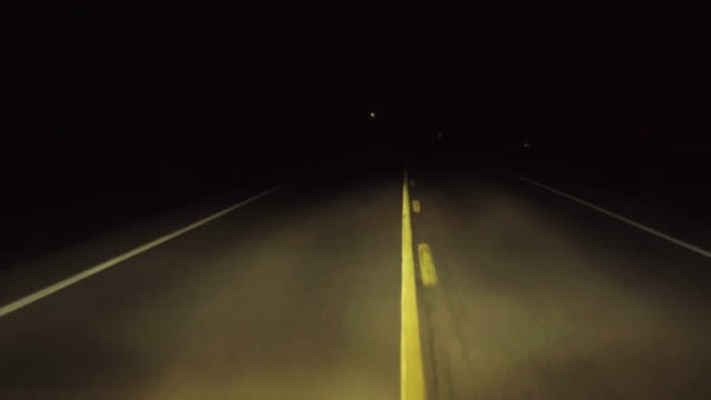 Driving dark country highway at night loop.