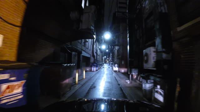 Driving down a narrow City Street video