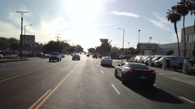 Driving down Martin Luther King Blvd 3. LOS ANGELES, CALIFORNIA - APRIL 14, 2019: Driving in South Los Angeles Traffic. Driving down Martin Luther King Blvd. The transformation from Santa Barbara Ave. to Martin Luther King Blvd. began with businessman Celes King III. Mr. King III strongly believed L.A. should and must have a street named after the civil rights activist. civil rights stock videos & royalty-free footage
