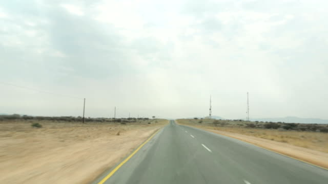 Driving down straight road in rural South Africa video