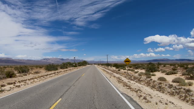 Driving down the endless desert road