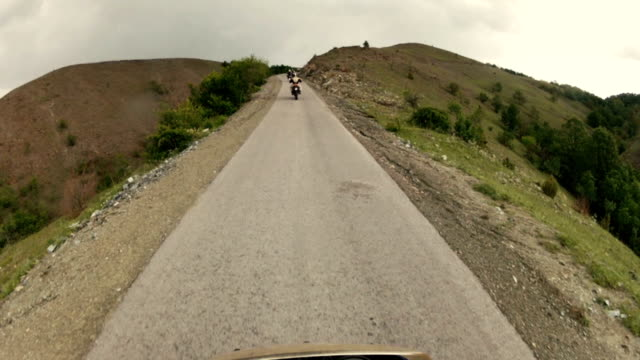 Driving enduro motorcycle on mountain road video