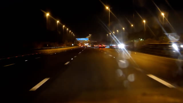 driving from liverpool to manchester at night - england stock videos & royalty-free footage