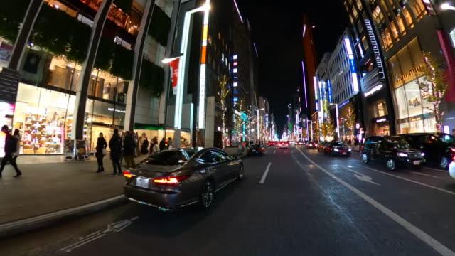夜の銀座通りを運転する - 陸の乗り物点の映像素材/bロール