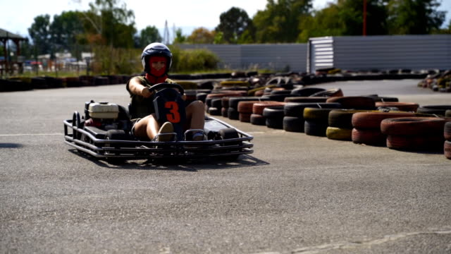Driving go-cart,super slow motion video