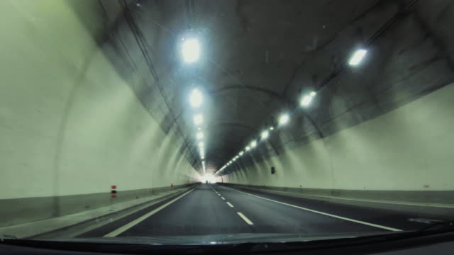 POV Driving highway: light out of the tunnel