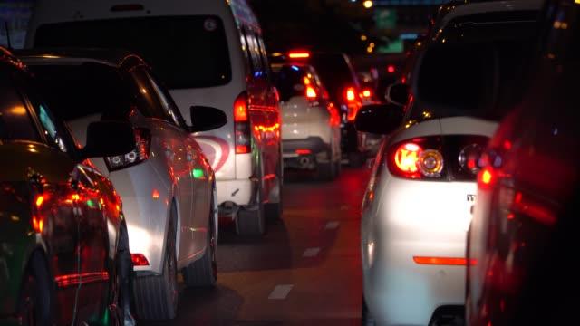 Driving in a car through city at night in Bangkok