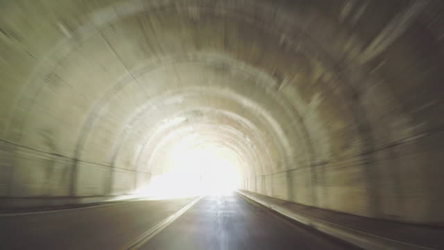 pov driving in and out the tunnel - viaggio su strada video stock e b–roll
