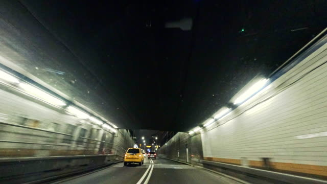 Driving in Holland Tunnel, from Driver Point of View Driving in Holland Tunnel, from Driver Point of View. 4K UHD accelerated hyperlapse-style video taken with action camera. Manhattan, New York City, NY, USA. tunnel stock videos & royalty-free footage