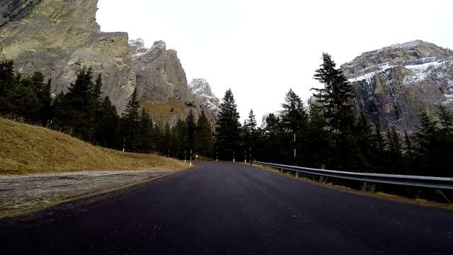driving in mountains on board camera - сельская дорога стоковые видео и кадры b-roll
