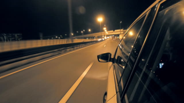 Driving in night highway, blurred timelapse. View from outside car cabin