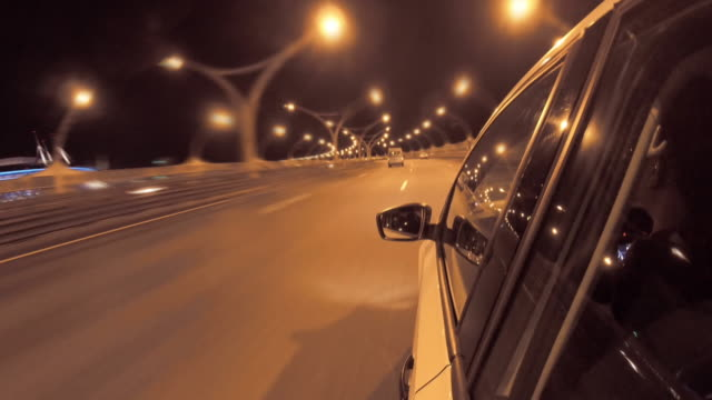 Driving in night highway timelapse. View from outside car cabin Driving in night highway timelapse. View from outside car cabin treedeo speed way stock videos & royalty-free footage