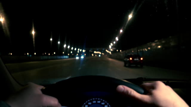 Driving in night scenery, hands on steering wheel. video