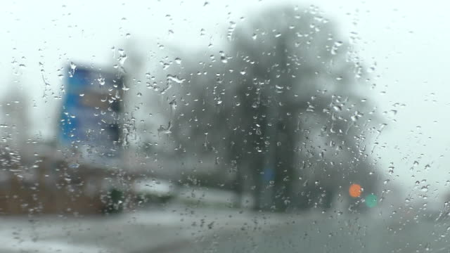 Driving in sleet, focus on windscreen video
