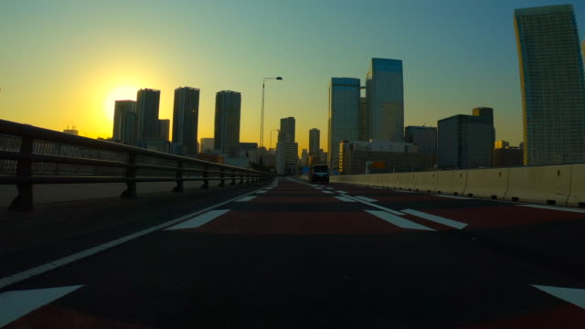 Driving in the city at Dusk Driving in the city at Dusk angle stock videos & royalty-free footage