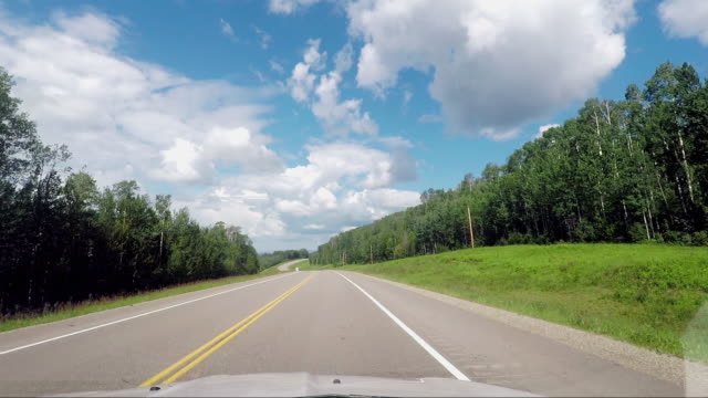 Driving in the Landscape of Yukon in Canada Driving in the Landscape of Yukon in Canada horizon over land stock videos & royalty-free footage