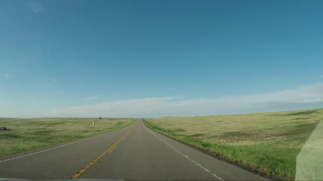 Driving in the Prairie of Canada Driving in the Prairie of Canada horizon over land stock videos & royalty-free footage
