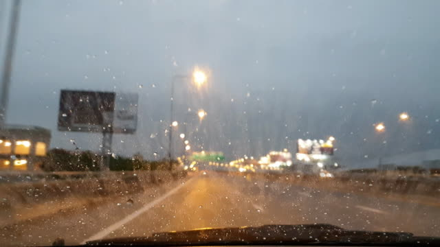 Driving in the rains. View through the windshield.