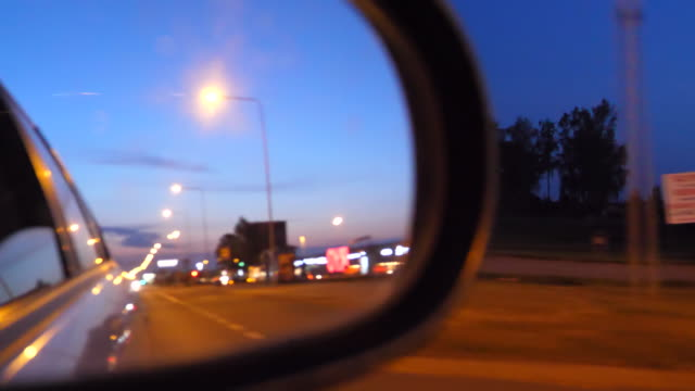Bидео Driving in town in Lithuania at night rear view mirror