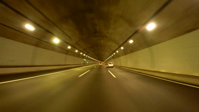 driving in tunnel -super low angle- - concrete architecture stock videos & royalty-free footage