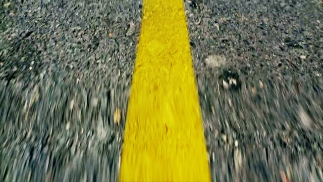 Driving lines High speed POV of a drivig line road yellow stock videos & royalty-free footage