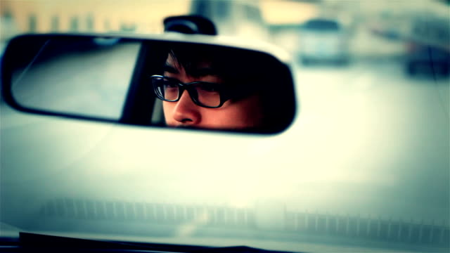 driving  man A Chinese man is driving on the highway rear view mirror stock videos & royalty-free footage