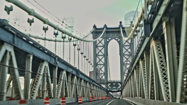 Driving Manhattan Bridge. Driving Manhattan Bridge, unusually deserted because of the Coronavirus Pandemic. New York City, USA manhattan bridge stock videos & royalty-free footage