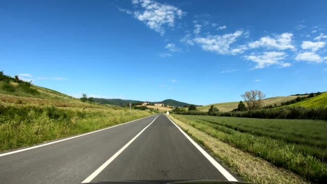 Driving on a country road in Tuscany, Italy