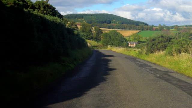 Driving on a countryside road in the Scottish Borders POV Driving on a countryside road in the Scottish Borders POV country road stock videos & royalty-free footage