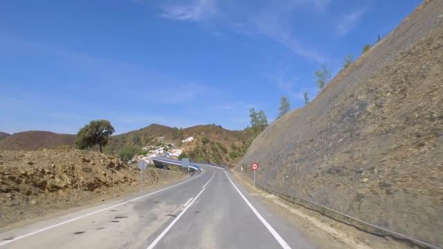 vídeos de stock e filmes b-roll de driving on a road near dam - barragem portugal