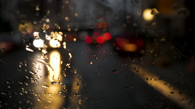 Driving on a street - defocused traffic lights and cars