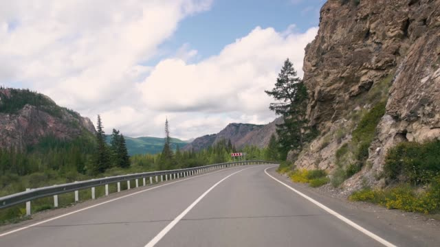 Driving on a summer mountain road