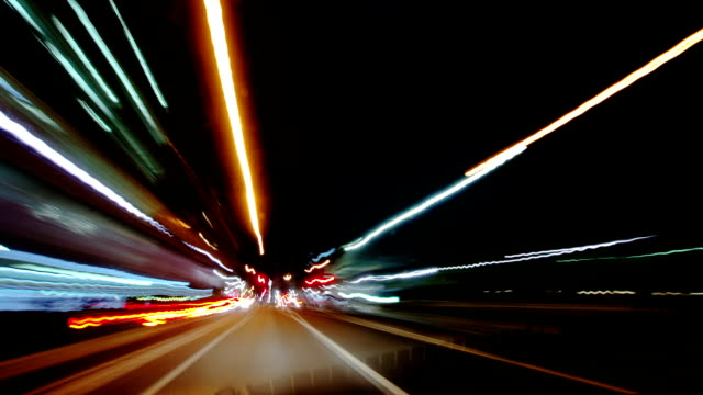 POV T/L Driving on busy city streets at night. video