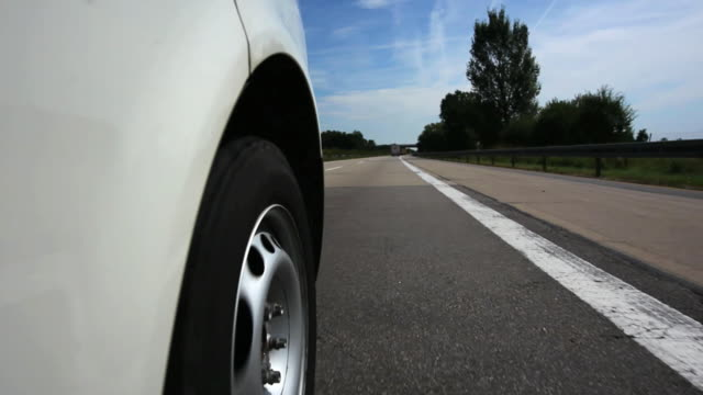 HD Driving on Damaged Road Driving on sub-standard road surface of two lane  highway shot from car point of view.   Shot with CARL ZEISS Distagon 21mm f/2,8 T* lens. autobahn stock videos & royalty-free footage