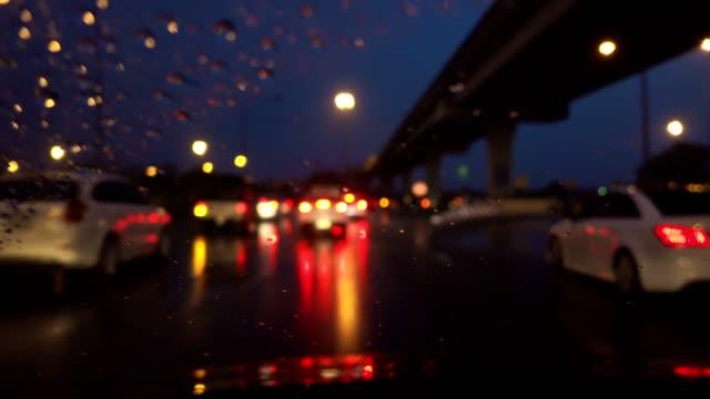 Driving on dark rainy night, handheld.